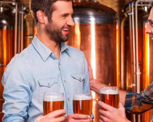 West-End-Central-Apartments-XXXX-Brisbane-Brewery-tour-3-men-enjoying-a-beer